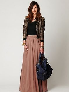 "Mad Cool Skirt  Style: 23881212  Jersey knit maxi skirt with two front pockets and elastic waist.     *60% Cotton, 40% Modal   *Machine Wash Cold   *Import     Measurements for Size Small:   Length: 44""   Waist (all around - relaxed): 28""   $88.00"