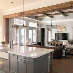Exposed wood beams framing through way from kitchen to living room.beautiful warm touch accentuating both rooms! Modern Farmhouse Kitchens, Farmhouse Kitchen Decor, Kitchen Redo, Home Decor Kitchen, Home Kitchens, Kitchen Ideas, Farmhouse Homes, Kitchen Island With Bar, Interior Design Farmhouse