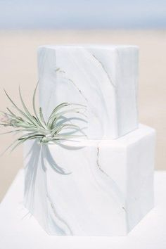 Desert Hexagon Marble   Marble Wedding Cakes for a Modern Bride. I am obsessed with these marble wedding cakes. They have been having a moment for a while and brides are thrilled to have a marbled wedding cake for their big day. These outstanding cakes come in just about any shade you like. Check out these insanely beautiful marble wedding cake ideas perfect for the modern bride! #weddings #weddingcakes #marblecakes