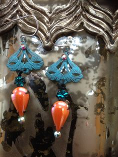 Patina focal with iridescent orange and blue vintage stones finished with Swarovski crystals $28