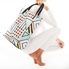 The Soft Pop Tote Bag is a chic every companion with its simple yet sophisticated geometric prints. It is a walking post-modern art work. The clear geometric pattern heighten the simple style of a streamlined tote bag. You never need to worry about being out of style with this creative design bag. #totebag #totebagforsale