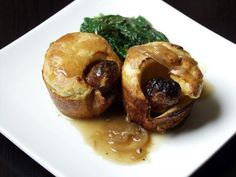 Toad in the Hole with Crock Pot Onion Gravy - Toad in the Hole is an old English comfort-food standby. Sausages, lovely and browned, cooked in Yorkshire Pudding batter that rises light, crisp and hollow — so you have a bowl for the gravy. Sausage Recipes, Meat Recipes, Cooking Recipes, Sausage Meals, Yummy Recipes, Yorkshire Pudding Batter, English Food, English Recipes, Kitchens