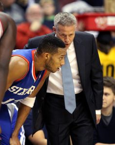 76ers win again, beat Bulls | Philadelphia 76ers' Brett Brown, right talks to Evan Turner as they play the Chicago Bulls in the first half of an NBA basketball game Saturday, Nov. 2, 2013, in Philadelphia. (AP Photo/H. Rumph Jr)