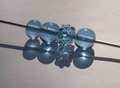 wine glass bottle beads are awesome but there are other things that are more doable.--upcycling.