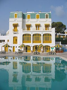 The Hôtel Les Mimosas in Tunisia was formerly the vacation home of the French colonial governor. Love that pool!