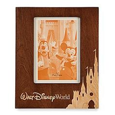 [Photo fantasy]Treasure magical memories of your <i>Walt Disney World</i> visit forever in this handsome wood frame with Resort logo and inlaid Cinderella Castle silhouette. A 5'' x 7'' window presents your portrait photo in fine style.