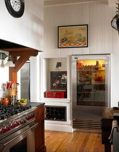 """""""With a glass-door refrigerator, you can see what you have at a glance,"""" says designer Craig Kettles. """"But I do find myself styling the shelves."""" Refrigerator by Sub-Zero. gas range by Wolf. The red metal box holds bread. Old Kitchen, Kitchen Decor, Kitchen Ideas, Kitchen Ware, Pantry Ideas, Kitchen Stuff, Kitchen Designs, Vintage Kitchen, Kitchen Island"""