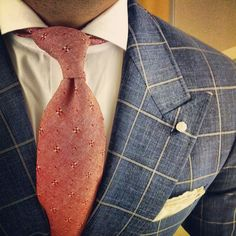 Love the peak lapels plus the fabric and desaturated colors.