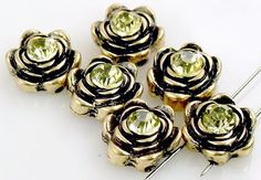 *Cast in antique gold with a large cz stone center in jonquil, that really is set off by the antique gold color in a rose design. They have 2 holes on each side for stringing that are approx. 7 mm apa