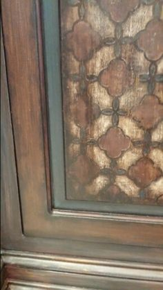 Close up. Faux wood door with Royal Design Studio stencil. Work by Tiffany Alexander of Blank Canvas Design Studio.