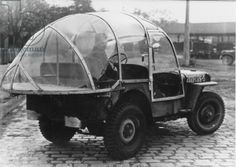 U.S. Army jeep from the Second World War with a plastic canopy as protection against weather (b/w photo)