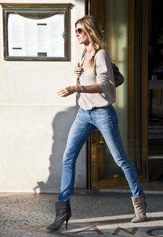 Gisele Bundchen Lookbook: Gisele Bundchen wearing Ankle Boots (6 of 10). Gisele looked ultra chic in skinny jeans tucked into gray suede ankle boots.