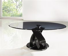 Was £199.99 Now £179.99 Twin Twirl Smoked Glass Coffee Table  The Twin Twirl Coffee Table is oval shaped heavy duty tempered glass for extra strength and durability.  The edges of the glass are polished and shaped offering the assurance of safety. Up to 70% discount on selcted items. Spend over four hundred and fifty pound and get an extra 5% off. Use discount code PINT5