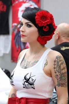 This rockabilly chick is really rocking her outfit! I am a huge fan of the swallows on her  shirt