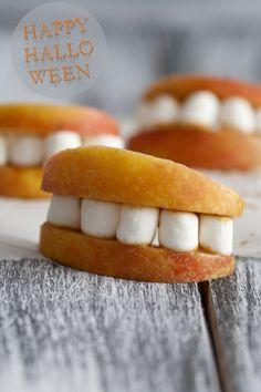 Cute snacks for Halloween - apples, peanut butter, and marshmallows  #szmandadental #holiday #recipes