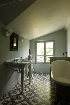 patterned tiles attic bathroom clawfoot tub vintage