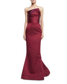 Zac Posen satin gown with two-tone bodice. Angled strapless neckline; folded at back. Seam across natural waist. Subtle trumpet silhouette. Back godet train. Hidden back zip. Nylon. Made in the USA of