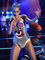 """Cyrus opened the performance with her girl-power party single, """"We Can't Stop."""" And it was, um, an interesting sight to behold. She came onstage in a very revealing bustier/hot pant combo accompanied by giant dancing teddy bears and combined her summer song with the summer's dance craze, twerking -- with a bear."""