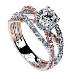 Crossover rings are becoming more apparent today and this one of my favourites. Mark Silverstein Got it just right with this 18k white and rose gold triple band crossover, containing both pink and white diamonds. Just gorgeous and not too much of a splurge at $4.5k