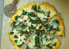 """Cauliflower Crust Spinach White Pizza -- The secret for the perfect paleo crust lies in squeezing out all the moisture from the cauliflower """"flour""""."""