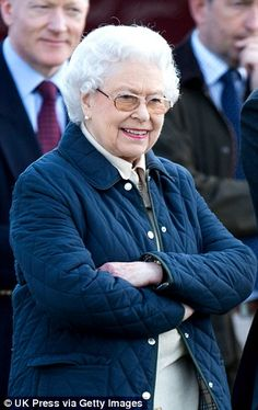 Practical: The Queen wore a padded coat and tartan skirt 14 May 2014