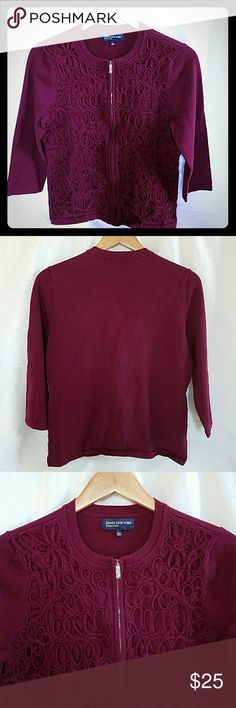 Jones New York Sweater This lovely sweater is a deep magenta and is perfect for spring time! The color is very true to the first picture, but not exactly the rest, so please keep that in mind. This is in excellent condition! It looks as though it was given as a gift and the person took the tags off, but never wore it. The zipper is still wrapped in plastic. Fiber content: 88% combed cotton and 12% nylon Jones New York Sweaters Cardigans