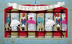 "Use our The Nutcracker Tale Christmas Crackers by Meri Meri to give your party a festive ""pop!"" Enjoy their elegant holiday look as part of your holiday table and then let guests enjoy them. Give a Meri Meri Festive Party Cracker a sharp tug and it will pop open. MEMBER - Make It Mine Parties"