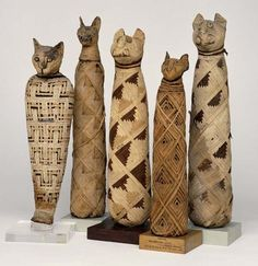 Wonderful picture of Egyptian mummy cats with log cabin motif on the wrappings