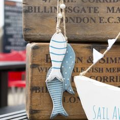 https://www.sassandbelle.co.uk/Wooden Fish Hanging Decoration in Blue