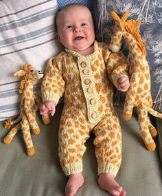 Free Knitting Pattern for Giraffe Onesie - Buttoned front baby onesie with spots in stranded colorwork. Toy patterns are sold separately. 5 sizes XS (0-3 months), S (3-6 months), M (6-9 months), L (9-12 months) and XL (12-18 months). Designed by Christine Grant of Mad Monkey Knits. DK weight.