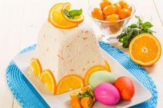Пасха с апельсином. творога - 800 г сливочного масла - 100 г сливок 33% жирности - 150 мл яйца - 3 шт. сахарной пудры - 200 г апельсиновых цукатов - 100 г цедра - с 2 апельсинов