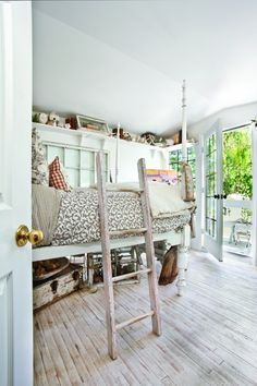 This cozy bedroom has an enchanting treehouse-like feel. Perfect for children of all ages!