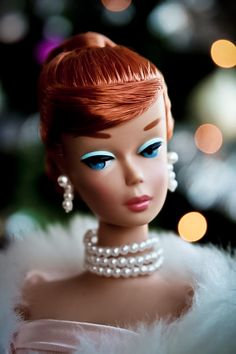 Remember putting Barbie necklaces on?!!!!  Christmas Barbie with Pearls