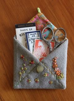 These would be sweet pockets to hang as ornaments on the tree for wish gifts...This says:Free Project! Envelope Needle Case - C&T Publishing