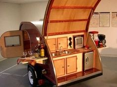 Want to tailgate in style? This 'Ultimate Camper' will turn some heads. It's a cedar-lined deluxe teardrop camper-trailer that's totally tricked out with a camper's galley including double sinks, water pump, mini fridge, wine rack and side tables. It's wired for electricity and includes a TV/DVD player, too.