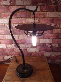 ART LAMP FROM A 70'S LAMP BASE, DISCARDED AND BROKEN. RESURRECTED, IT NOW IS A STYLISH AND CURVY FASHION STATEMENT, WITH A CUSTOM SHADE OF A MARINE CAGE, WITH RECORD LP , PAINTED A STORMY NIGHT EFFECT. TOP IT ALL OFF WITH A EDISON CANDELABRA BULB, AND YOU HAVE A THING OF BEAUTY.