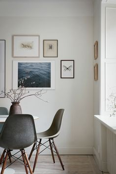 dining room in neutral colors and gallery wall