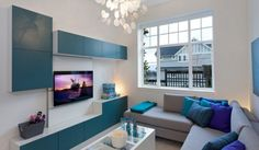New Playful And Colorful Home Interior Decor: cozy living room with blue accents on cabinetry and pillow also with beige corner sofas and wh...