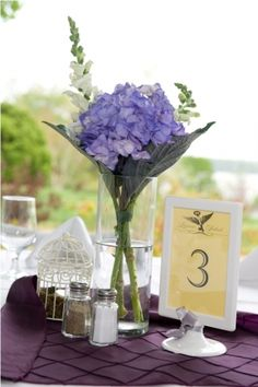 Love the use of textured napkins as centerpiece cloths #weddings #table #centerpiece #purple