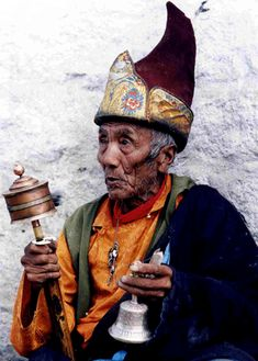 Old monk in Lhasa http://exploretraveler.com* Arielle Gabriel writes about miracles and travel in The Goddess of Mercy & The Dept of Miracles also free China toys and paper dolls at The China Adventures of Arielle Gabriel *