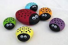 DIY rock painted lady bugs. Sooo cute. Did this for my girl on her 1st birthday - theme: in the garden.