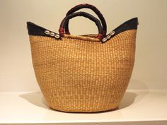 Fibre, leather and cowrie shell basket, Ghana