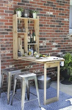 Think you don't have room for a bar, dining nook, or food prep station in your small outdoor space? Think again. These DIY tables, bars, and carts fold flush to the wall, wheel inside, and make use of plain ole' efficient design—turning the dream of al fresco dining into a reality for small space dwellers.