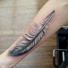 Love feather tattoo.
