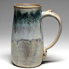 "Handcrafted coffee and tea mug with a comfortable handle. Made from high fire stoneware in a shape that holds in the heat, with a thumb thing for better gripping. This ""tankard"" holds around and is about tall. Slab Pottery, Glazes For Pottery, Pottery Mugs, Ceramic Pottery, Pottery Designs, Pottery Ideas, Sculpture Clay, Ceramic Sculptures, Clay Mugs"