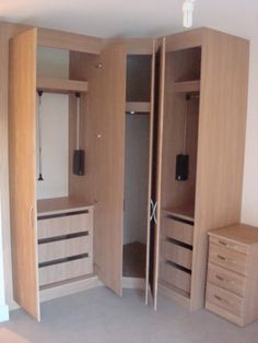 Great space creating furniture with a corner wardrobe with pull-down hanging rails. Designed in our Contour Range.