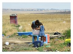 Indian Reservation   Pine Ridge Reservation. Family bathing an infant. Every ingrate in U.S should visit this place for 48 hrs or more.