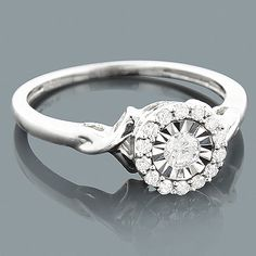 This 10K Gold Cheap Diamond Engagement Ring has a look of a ring with 1 carat center diamond due to its unique diamond setting and showcases 0.27 carats of sparkling round diamonds, and is available in 10K white, yellow and rose gold. This lovely diamond ring makes an affordable pre-set diamond engagement ring or promise ring.