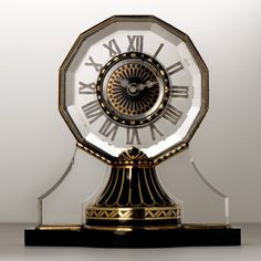 Boucheron art deco table clock from about 1921. The clock is in gold and black enamel on mostly rock crystal (very hard to cut).
