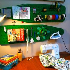 2 old ironing boards + peg board hooks = cool craft storage and magnet board!